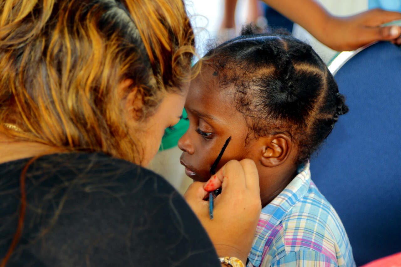 Face painting always fascinates children at these functions. The long lines remained until almost closing time
