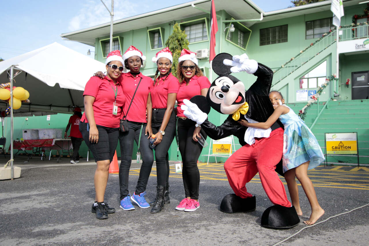 Staff sharing in the fun with Mickey Mouse